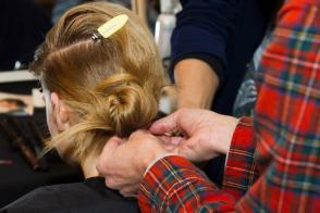 Guido/Redken creates soft chignons backstage at Rag & Bone FW 2013 show